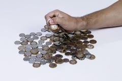 处理巴西真正的硬币 免版税图库摄影