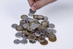 处理巴西真正的硬币 免版税库存照片