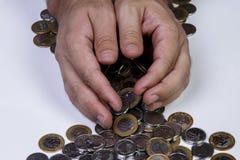 处理巴西真正的硬币 免版税库存图片