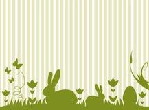 复活节兔子和鸡蛋在草甸 库存图片