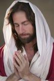 复活节上升的祷告手 免版税图库摄影