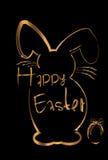 复活节在金子的背景兔宝宝 库存照片