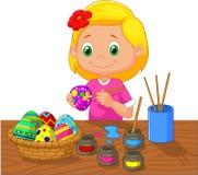 绘复活节彩蛋的动画片女孩 图库摄影