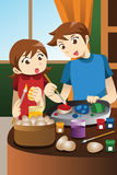 绘复活节彩蛋的孩子 免版税图库摄影
