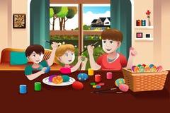 绘复活节彩蛋的孩子 库存图片