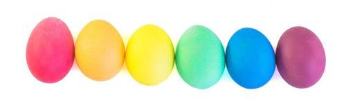 复活节彩蛋行在空白背景查出的 图库摄影