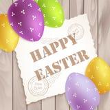 复活节海报用在木头的五颜六色的鸡蛋 库存照片