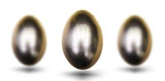 复活节的金黄鸡蛋在白色背景 图库摄影