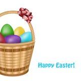 复活节篮子用五颜六色的鸡蛋 免版税库存照片