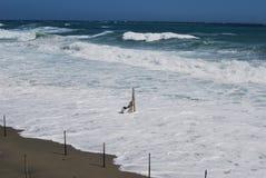 夏天末端在海滩的海风暴 免版税库存照片