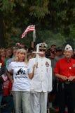 夏天白色服装的海军官员在救球我们的发怒集会,诺克斯维尔,衣阿华 免版税图库摄影