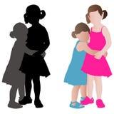 夏天礼服拥抱的两个可爱的小女孩 图库摄影