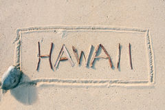 夏威夷书面的沙子棍子 库存图片