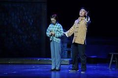 外向性的兄弟和性格内向的姐妹江西歌剧杆秤 免版税图库摄影