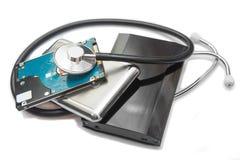 外在硬盘和听诊器 免版税库存照片