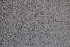 外墙参差不齐的粒状灰色表面  免版税库存照片