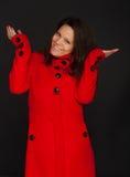 外套模型红色佩带的冬天年轻人 库存照片