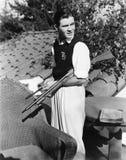 外面年轻人画象与枪(所有人被描述不更长生存,并且庄园不存在 供应商保单那 免版税库存照片