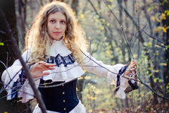 维多利亚女王时代的样式。俏丽的妇女 图库摄影