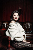 维多利亚女王时代的椅子的妇女 库存图片