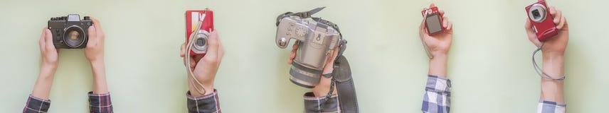 多只手拿着各种各样的照相机隔绝了创造性的f 免版税库存照片