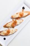多士bruschettes冠上用乳酪和柑橘阻塞 免版税库存照片