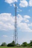 多孔的通信大塔在领域的 免版税库存照片