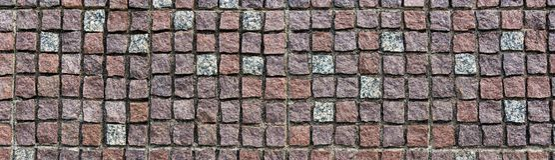 多彩多姿的石墙被仿造的表面 库存照片