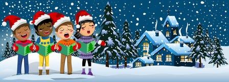 多文化孩子xmas帽子唱歌圣诞颂歌空白的框架 免版税库存照片
