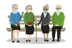 多文化老人坐长凳 库存照片