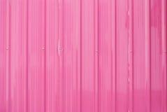 多灰尘的桃红色金属板背景纹理 免版税图库摄影