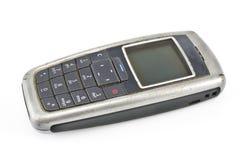 多灰尘的移动老电话 图库摄影