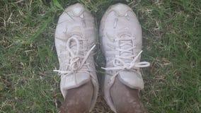 多灰尘的运动鞋 库存照片
