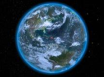 多米尼加共和国在地球上的晚上 免版税库存图片
