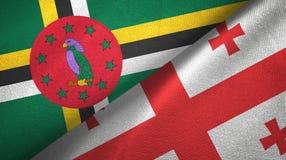 多米尼加和乔治亚两旗子纺织品布料,织品纹理 库存图片