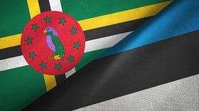 多米尼加和爱沙尼亚两旗子纺织品布料,织品纹理 免版税库存照片
