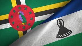 多米尼加和莱索托两旗子纺织品布料,织品纹理 免版税库存照片