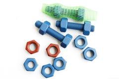 多缩木胶螺栓和坚果在蓝色用PTFE涂 库存图片