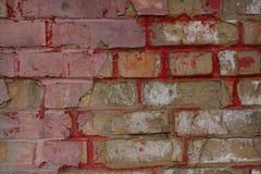 多色老和难看的东西砖墙 背景几何老装饰品纸张葡萄酒 古色古香的纹理在小镇 免版税库存照片