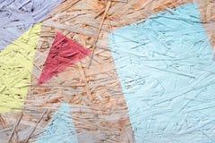 多色被绘的木粗纸板纹理背景 免版税库存照片