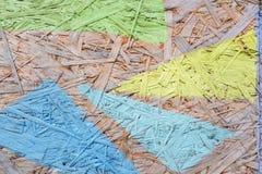 多色被绘的木粗纸板纹理背景 库存图片