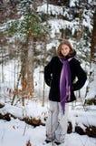 多雪森林的女孩 免版税图库摄影