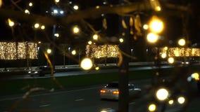夜光做的交通汽车塑造Bokeh圣诞节背景 影视素材
