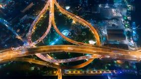 夜在4方式中止街道交叉点圈子环形交通枢纽路的城市交通时间间隔在曼谷,泰国 水平的4K UHD 影视素材