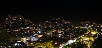夜场面在西疆Qianhu庙村 库存图片