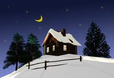夜空的背景的木房子。 免版税图库摄影