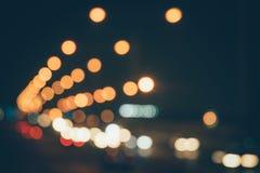 夜都市风景被弄脏的背景 夜城市光bokeh 免版税库存照片