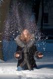 夜间乐趣多雪的采取的冬天妇女 免版税库存照片