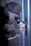 夜贼门锁挑选 免版税图库摄影