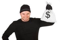 夜贼:拿着袋子现金的人 免版税库存照片